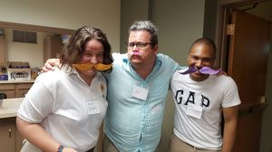 Our director, Sare Anuszkiewicz, Dr. Jon, a chaperone from Ohio, and Chris, the coordinator from Ohio, sharing the craft of the day: really ridiculous mustaches. They were the latest craze...