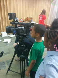 When the TV reporter arrived, the kids were captivated by the camera...